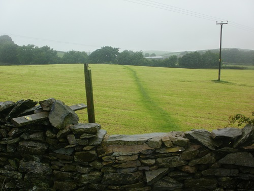 Wet grassy fields, walls and stiles would be common on the first day