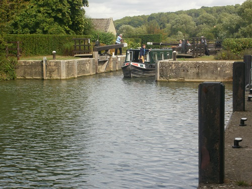 A narrowboat passes through a Lock on the River Thames